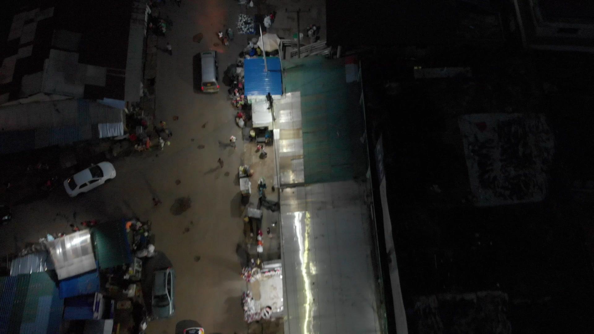 Koforidua Night Street Reverse Reveal Top Down View Cars Traffic Station